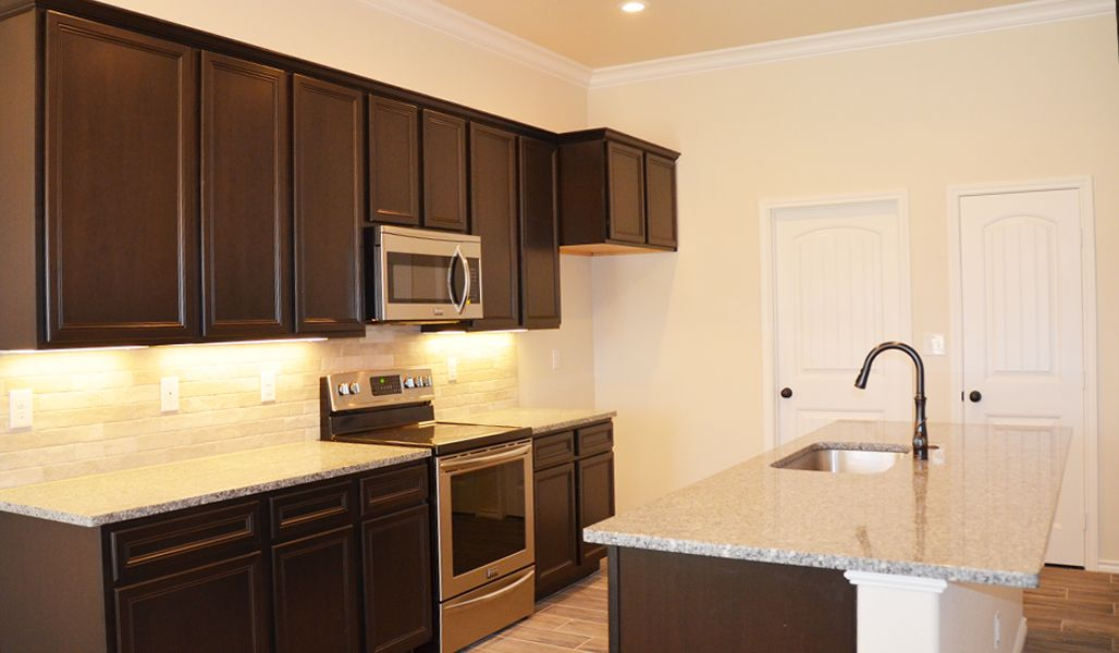 Kitchen featured in the Rosa By Betenbough Homes in Midland-Odessa, TX