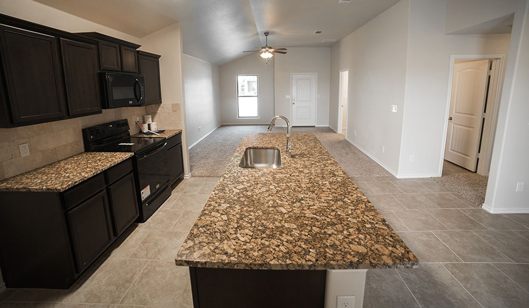 Kitchen featured in the Regan By Betenbough Homes in Midland-Odessa, TX