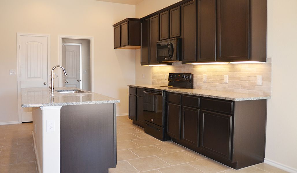 Kitchen featured in the Marie By Betenbough Homes in Midland-Odessa, TX
