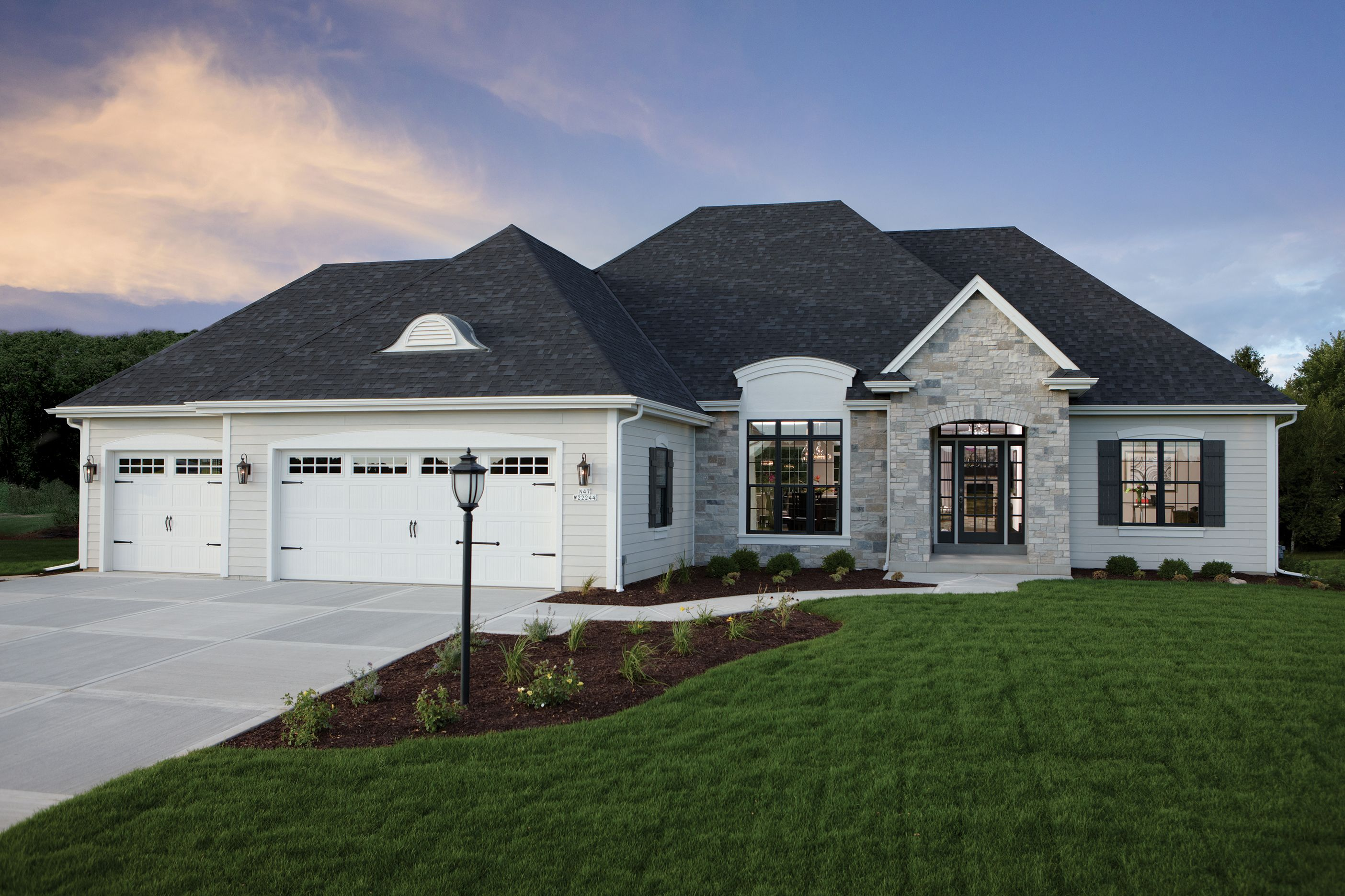 Exterior featured in The Clemont, Plan 2043 By Bielinski Homes, Inc. in Ozaukee-Sheboygan, WI