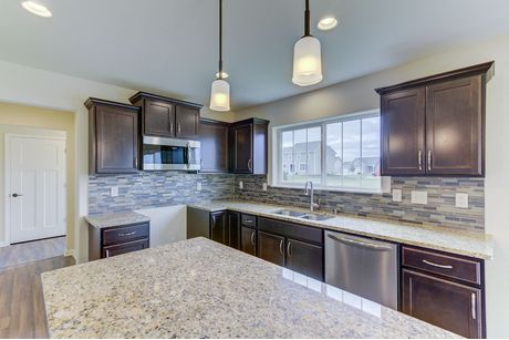 Kitchen-in-The Kaitlyn, Plan 2000-at-The Settlement at Utica Lake-in-Dousman