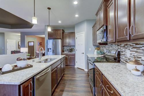 Kitchen-in-The Preston, Plan 1812-at-Bay Pointe Condominiums-in-Oconomowoc