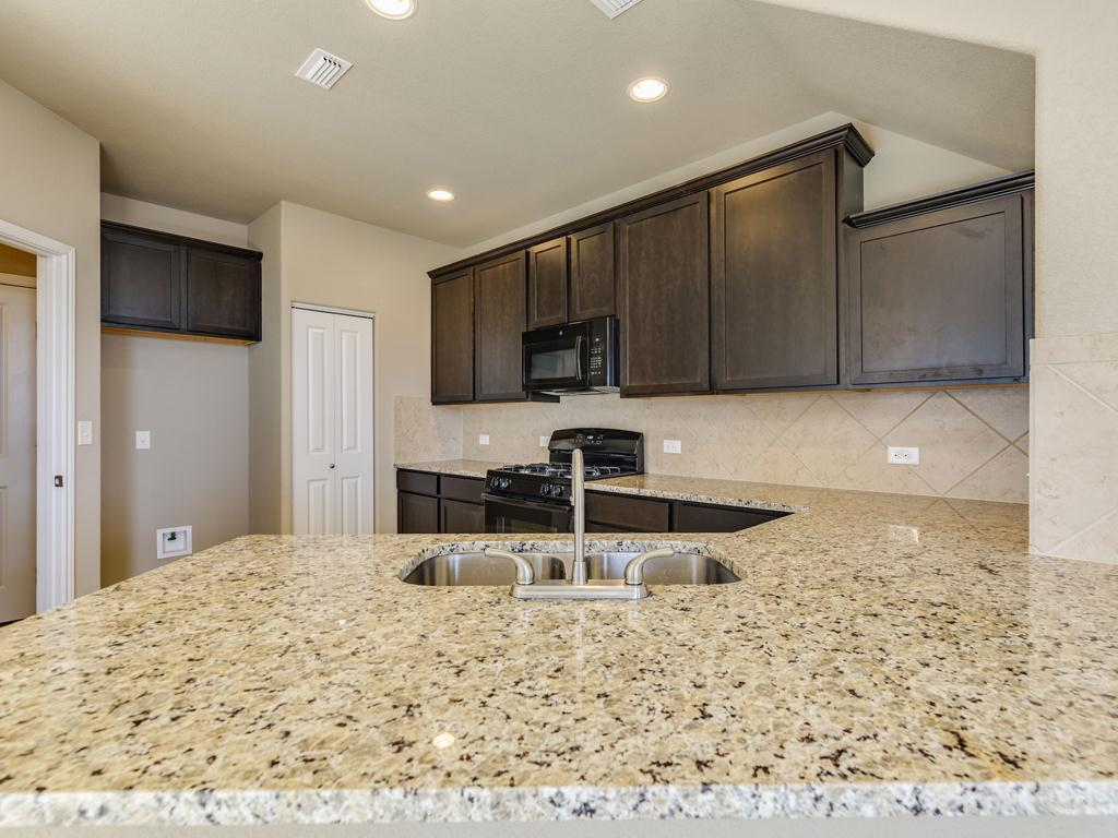Kitchen featured in The Adele Steiner By Bigelow Homes in Austin, TX