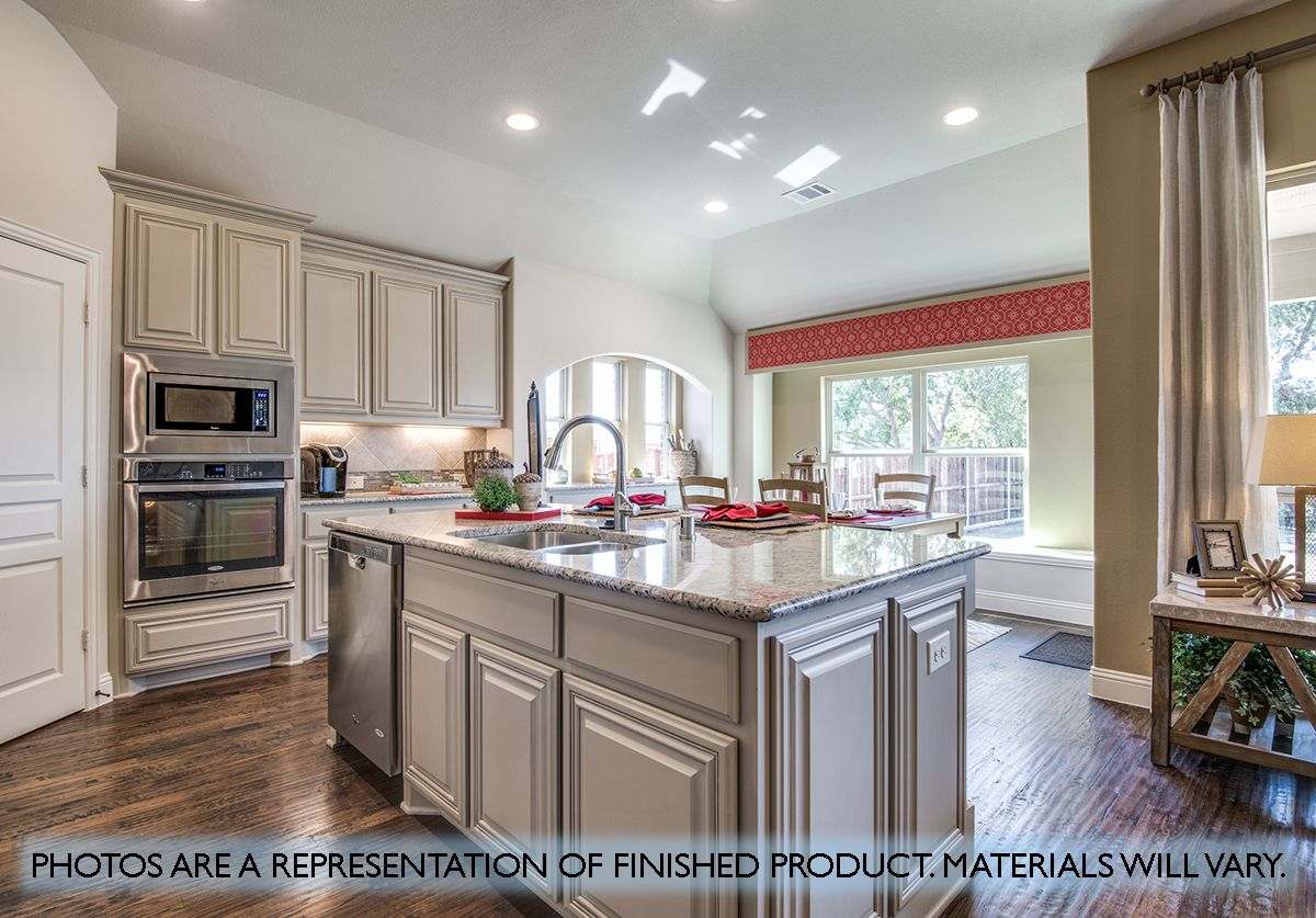 Kitchen featured in the Carolina II By Bloomfield Homes in Dallas, TX