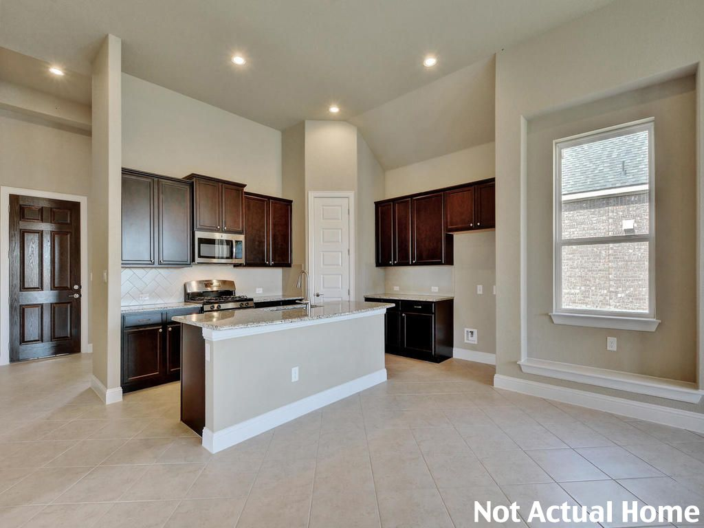 Kitchen featured in the 1793 By Brohn Homes in Austin, TX