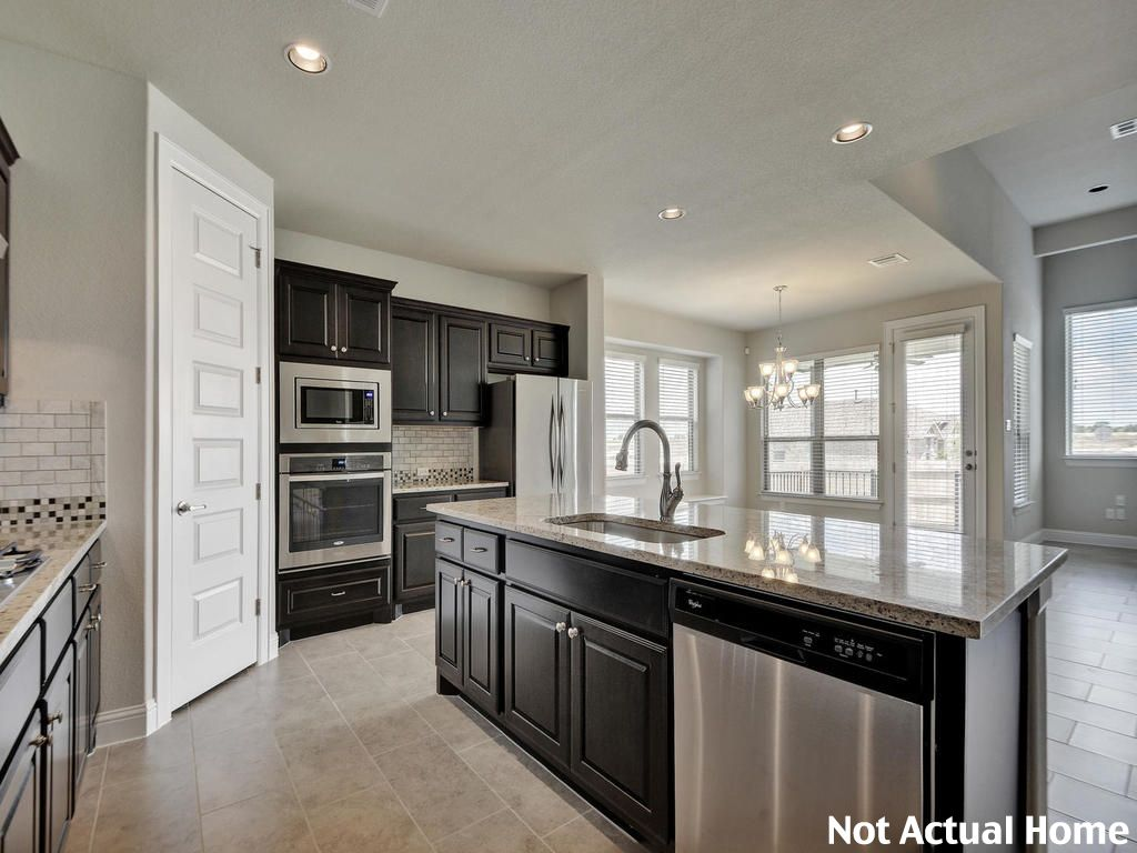 Kitchen featured in the 2694 By Brohn Homes in Austin, TX