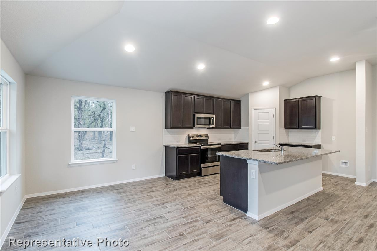 Kitchen featured in the Plan 1556 By Waterloo Homes in Austin, TX
