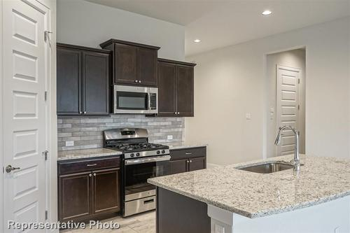 Kitchen-in-3262-at-The Enclave at Covered Bridge-in-Austin