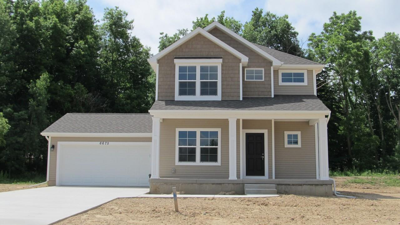 Exterior featured in the Harrison By CVE Homes in Jackson, MI
