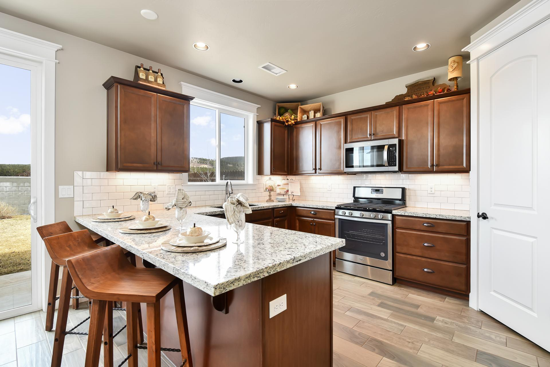 Kitchen featured in the Flagstaff Meadows Plan 1941 By Capstone Homes in Flagstaff, AZ