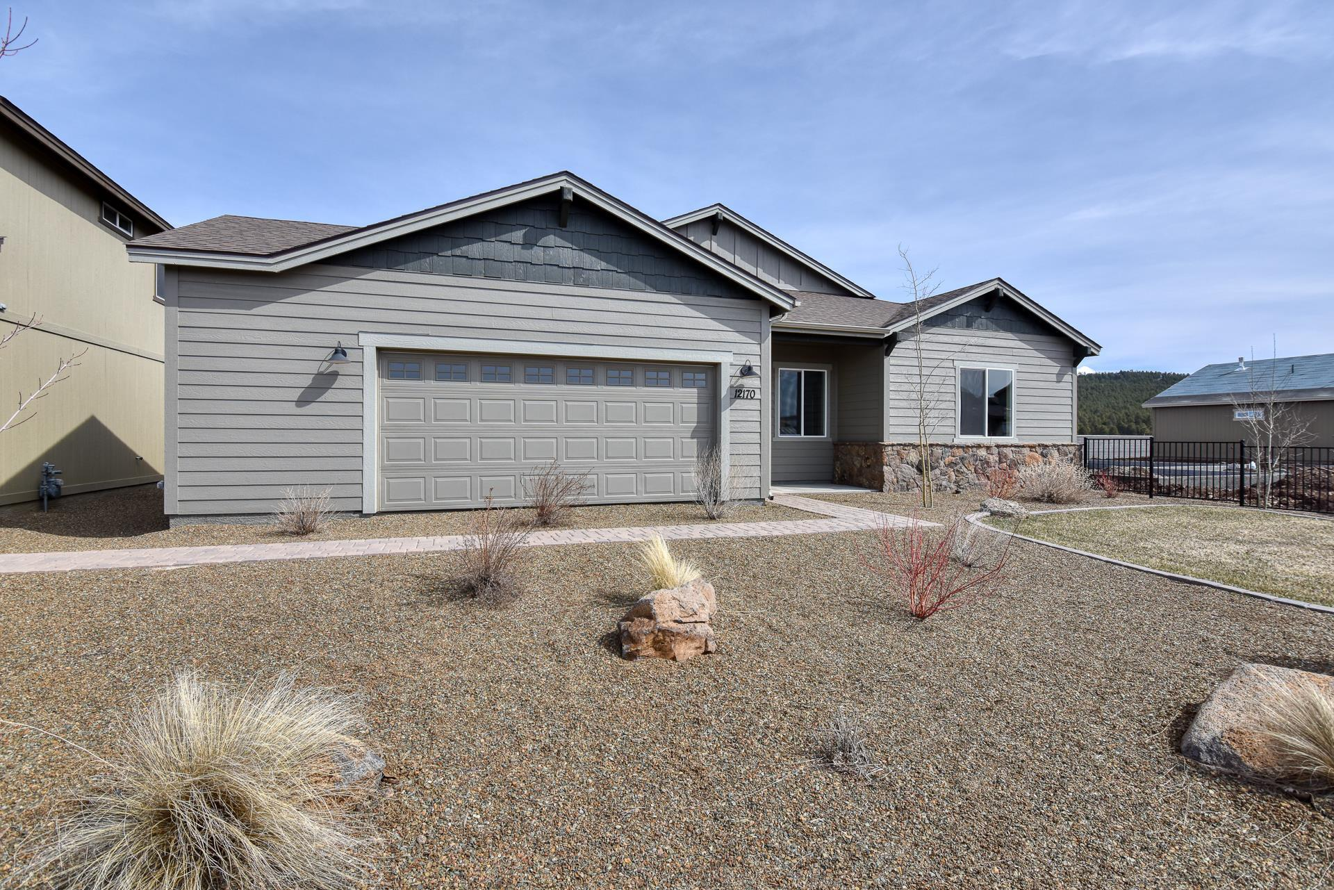 Exterior featured in the Flagstaff Meadows Plan 1896 By Capstone Homes in Flagstaff, AZ