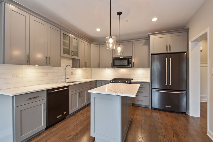 Kitchen:Custom painted cabniets with Black stainless steel appliances