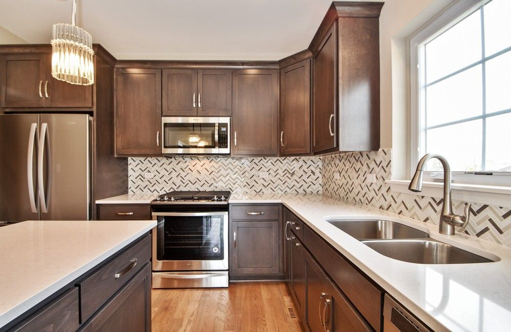 Kitchen featured in the Two Story Townhomes By Castletown Homes in Chicago, IL