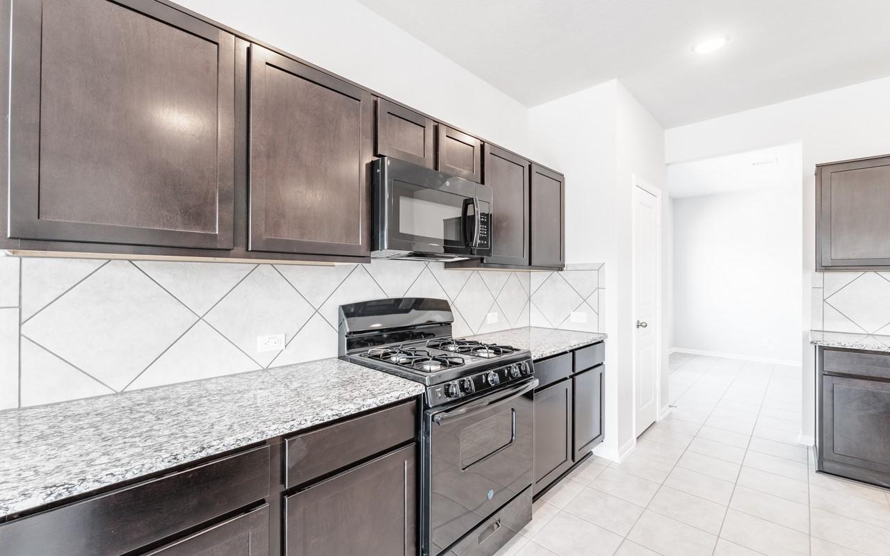 Kitchen featured in the Gemini-Cobalt By CastleRock Communities in Austin, TX
