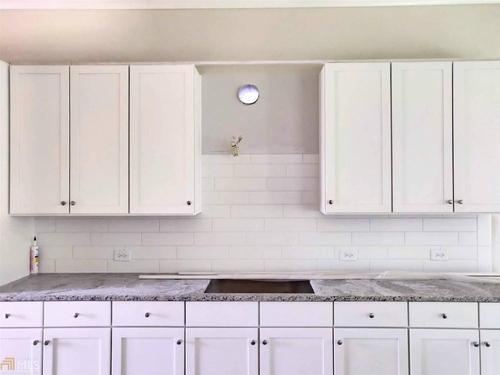 Kitchen-in-Oakhurst-at-Reserve at Bogan Lakes-in-Buford