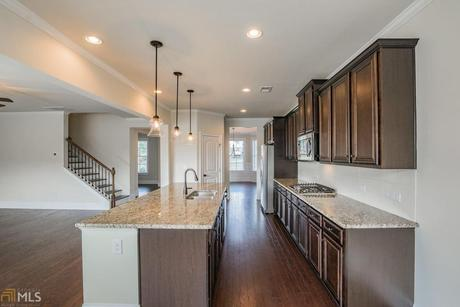 Kitchen-in-Oakmonte-at-Brookhaven at Durham Lakes-in-Fairburn