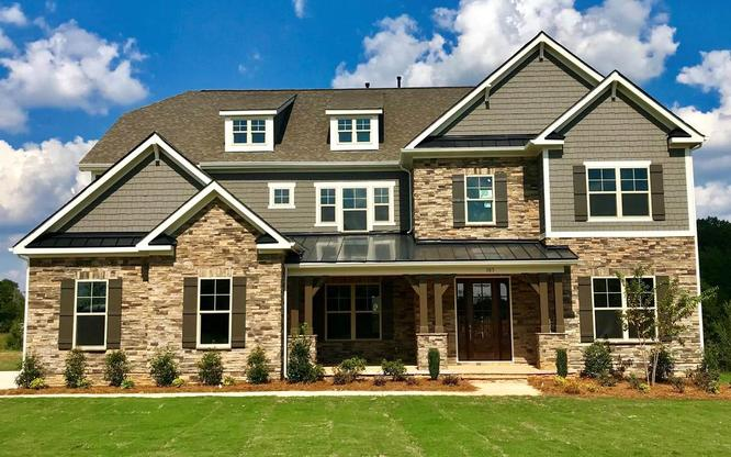 Exterior home featured at the Wyndmoor neighborhood built in The Carolinas division.:Stunning stone and brick exteriors
