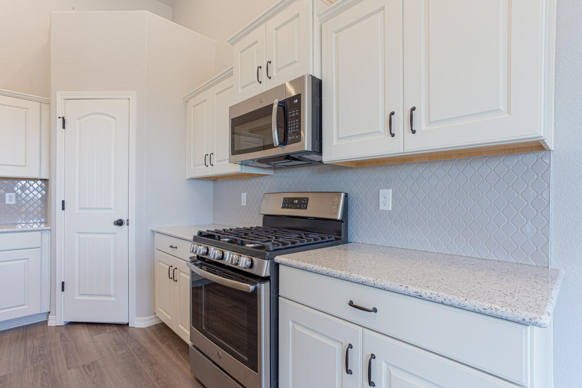 Kitchen featured in the Savannah By Challenger Homes in Colorado Springs, CO