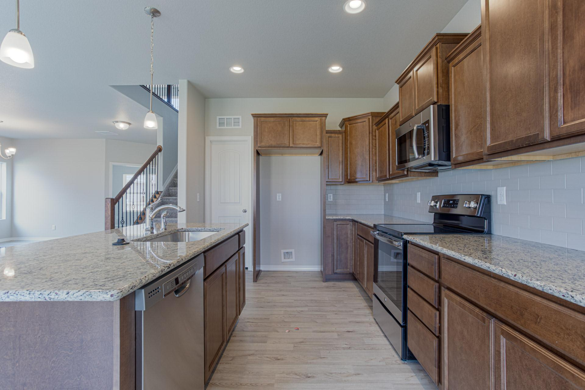 Kitchen featured in the Wilmington By Challenger Homes in Colorado Springs, CO