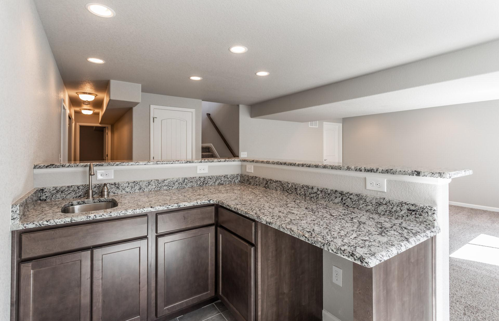 Kitchen featured in the Ponderosa By Challenger Homes in Colorado Springs, CO