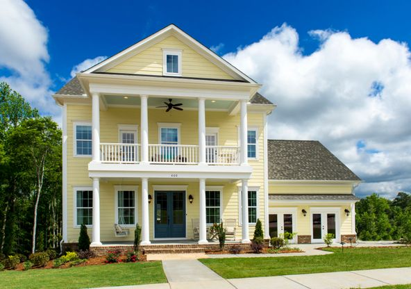 Dawson:Example of the Dawson Exterior 4 which features siding, double front sitting porch/deck and 2 car ga