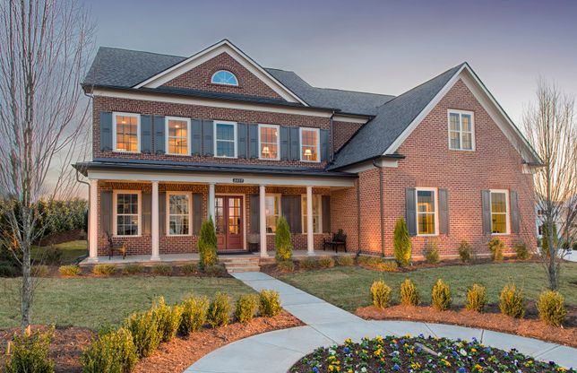 Maddox:Maddox Exterior 3 features brick, covered front porch and 3 car side load garage