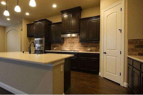 Kitchen-in-Abington Plan-at-Savannah – Executive Series-in-Aubrey