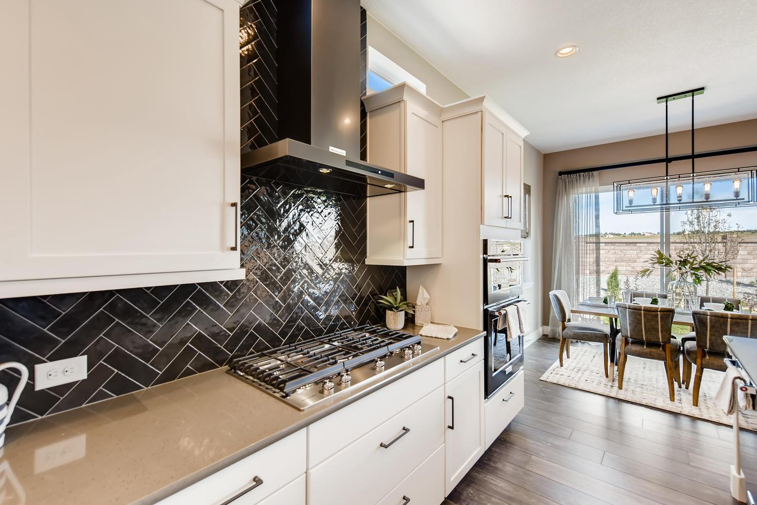 Kitchen featured in the Daylight By Classic Homes in Colorado Springs, CO