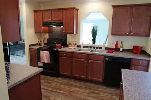 Kitchen-in-Grand Floridian / Floridian-at-Crossland Homes-Greenville-in-Greenville