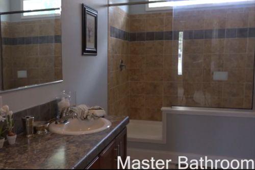 Bathroom-in-Greyson Manor-at-Crossland Homes-Greenville-in-Greenville