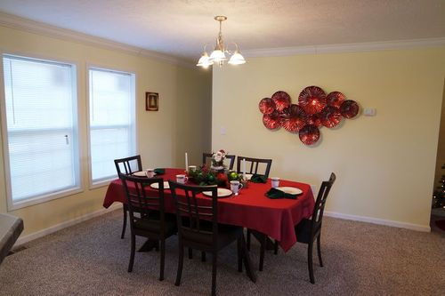 Dining-in-Christmas House-at-Crossland Homes-Greenville-in-Greenville