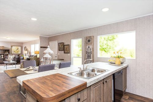 Greatroom-and-Dining-in-THE BREEZE II-at-Clayton Homes-Bryan-in-Bryan
