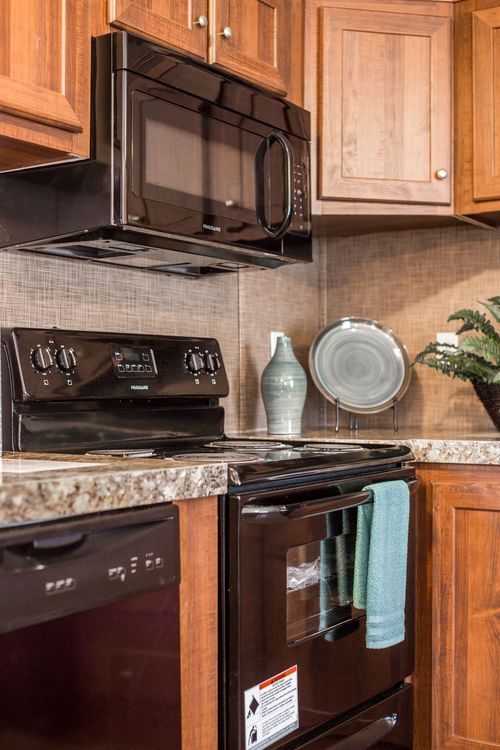 Kitchen-in-THE LOCKER ROOM-at-Clayton Homes-Cullman-in-Cullman