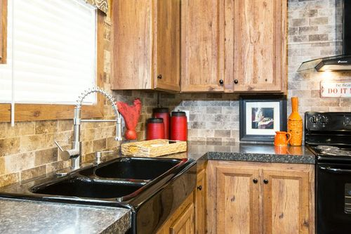 Kitchen-in-THE ALPINE RIDGE-at-Clayton Homes-Pearl-in-Pearl