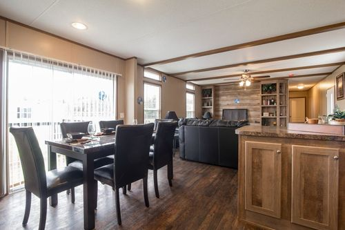 Greatroom-and-Dining-in-ANNIVERSARY 16763A-at-Oakwood Homes-Las Cruces-in-Las Cruces