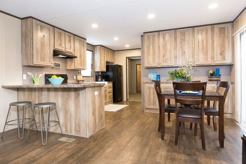 Kitchen-in-ANNIVERSARY 16763A-at-Oakwood Homes-Conroe-in-Conroe