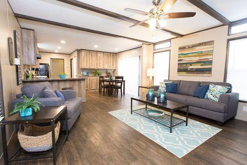 Greatroom-and-Dining-in-ANNIVERSARY 16763A-at-Oakwood Homes-San Antonio-in-San Antonio