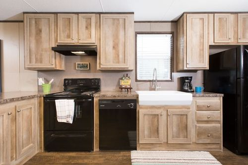 Kitchen-in-ANNIVERSARY 16763A-at-Oakwood Homes-Las Vegas-in-Las Vegas