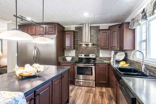 Kitchen-in-4710 ROCKETEER 7632-at-Clayton Homes-Youngsville-in-Youngsville