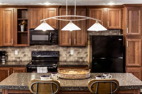 Kitchen-in-THE COMMANDER-at-Clayton Homes-Lowell-in-Lowell