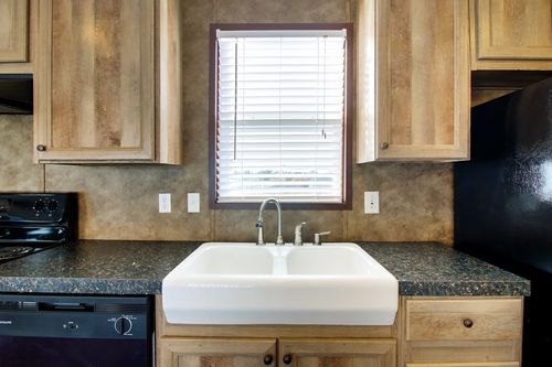 Kitchen-in-THE ANNIVERSARY 18-at-Clayton Homes-Fairview-in-Espanola