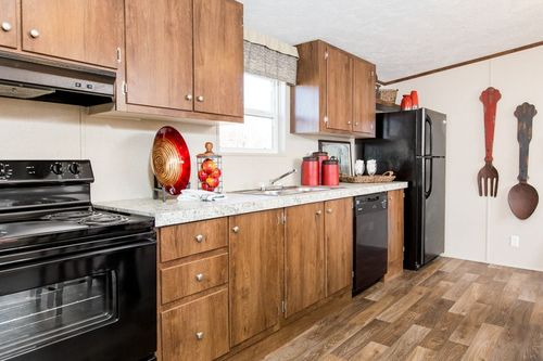 Kitchen-in-EXCITEMENT-at-Clayton Homes-Rogersville-in-Rogersville