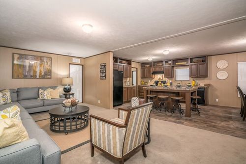 Greatroom-and-Dining-in-THE CHOICE-at-Oakwood Homes-Albuquerque-in-Albuquerque
