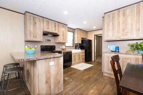 Kitchen-in-THE ANNIVERSARY-at-Clayton Homes-Natchitoches-in-Natchitoches