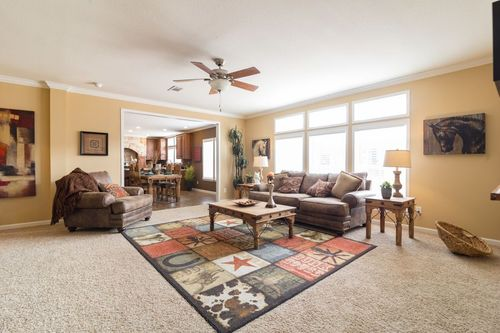 Greatroom-and-Dining-in-THE GREENSBORO-at-Clayton Homes-Lubbock-in-Lubbock