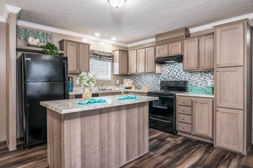 Kitchen-in-THE BISCAYNE-at-Crossland Homes-Candler-in-Candler
