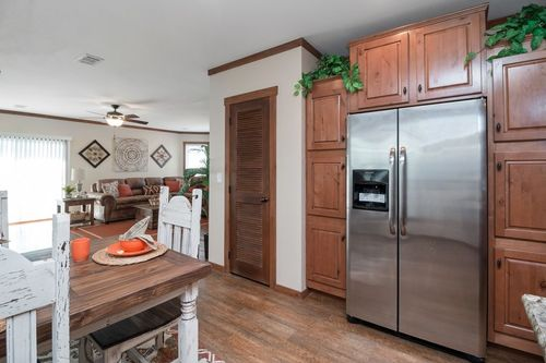 Kitchen-in-THE STEWART 32-at-Oakwood Homes-Las Cruces-in-Las Cruces