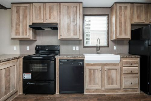 Kitchen-in-ANNIVERSARY 16682A-at-Oakwood Homes-Albuquerque-in-Albuquerque