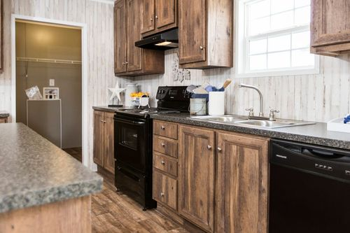 """Kitchen-in-NOW28603U """"NOW ULTRA""""-at-Clayton Homes-Dunn-in-Dunn"""