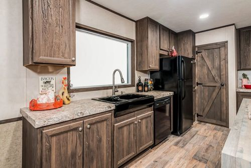 Kitchen-in-THE ANNIVERSARY 2.1-at-Freedom Homes-Lufkin-in-Lufkin